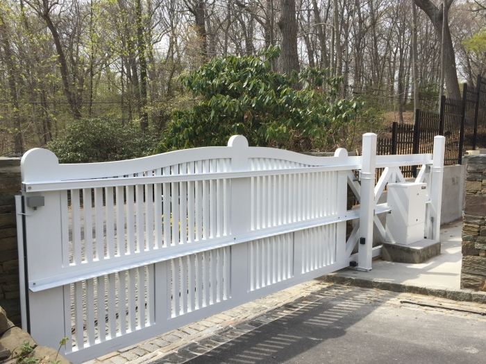 Custom Aluminum Cantilever Gate with a Custom White HySecurity 222 Operator