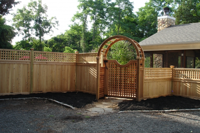Custom Wood Fence with Large Cedar Arbor