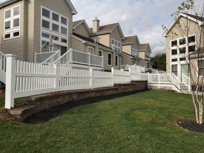 PVC Stepped Picket Fence on Retaining Wall